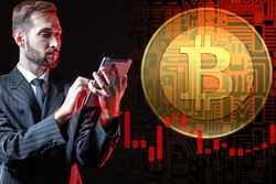 Trader next to bitcoin logo. Man with tablet is engaged in bitcoin trading. Trader next to cryptocurrency symbol. Concept - bitcoin trading using a mobile application. Cryptocurrency exchange trading