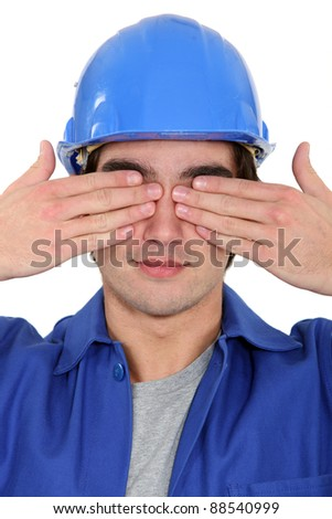 Tradesman covering his eyes