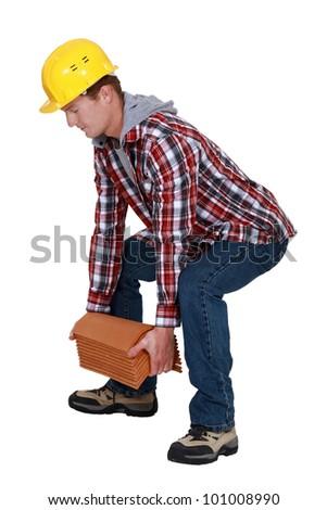 Tradesman lifting shingles
