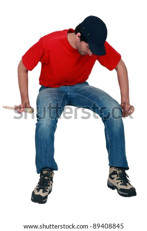Tradesman sitting on an invisible object