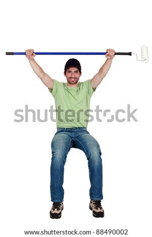 Tradesman sitting on an invisible object and holding up a paint roller