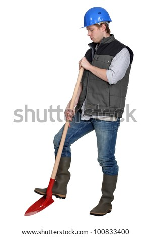 Tradesman using a spade - stock photo
