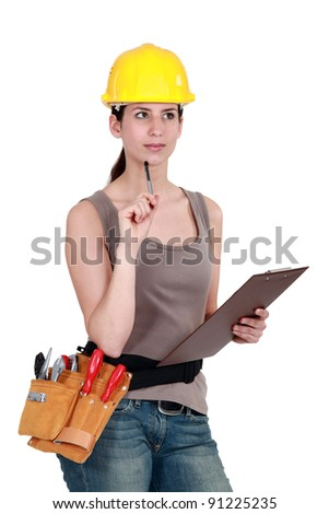 Tradeswoman completing an evaluation