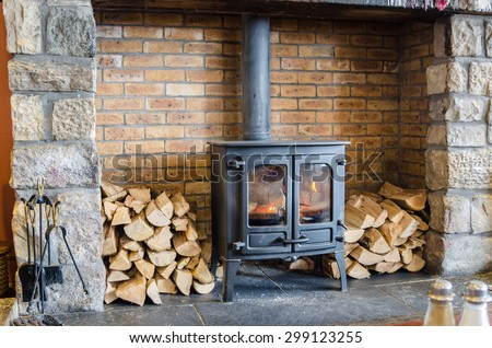 Tradional Wood Burning Stove in a Brick Fireplace Stock fotó ©