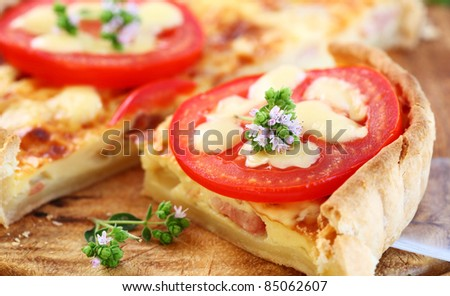 Tradition French bacon quiche with onion, tomato and cheese