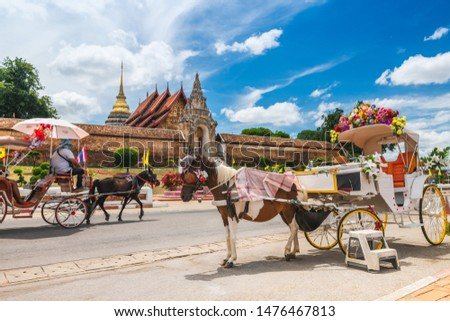 Tradition horse drawn retro carriage for traveler in front of Wat Phra That Lampang Luang, Attraction famous landmark tourist travel Lampang Thailand vacation trip, Tourism beautiful destinations Asia