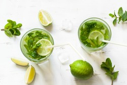 Tradition Summer drink mojito with lime and mint. Top view with copy space.
