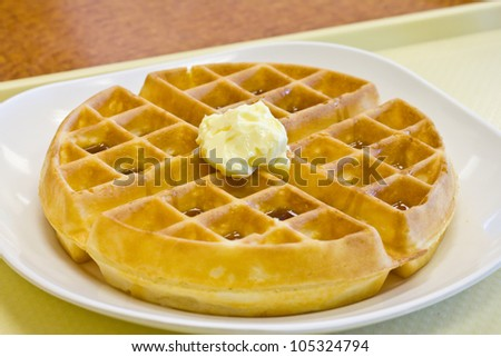 Tradition waffle with butter in white plate  on  the table