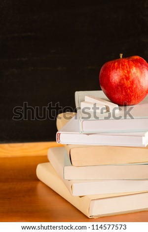 Traditional academic study pile of school books and apple