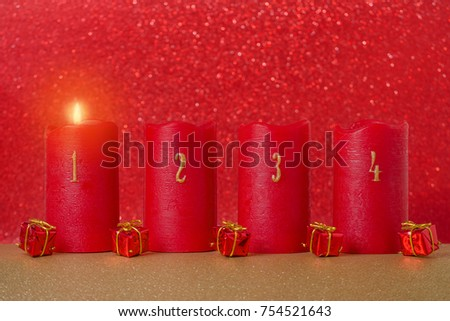 traditional advent candles with numbers and gifts on red background #754521643