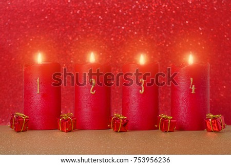 traditional advent candles with numbers and gifts on red background, selective focus #753956236