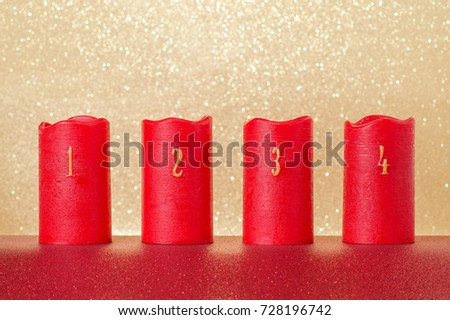 traditional advent candles with numbers and gold background, copy space #728196742