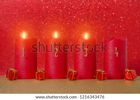 traditional advent candles with numbers on red background #1216343476