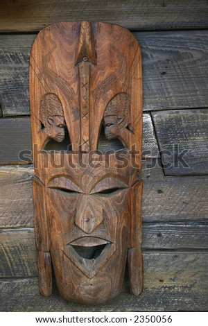 Traditional african mask hanging on board wall