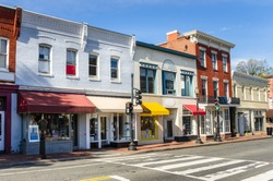Traditional American Brick Buildings with Colourful Shops along a Brick Pavement