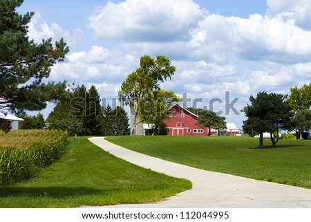 Traditional American Countryside Farm With Cloudy Sky