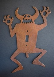 traditional american ethnic metal sculpture of a devil