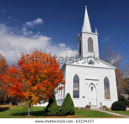 Traditional American white church in the fall #63234337