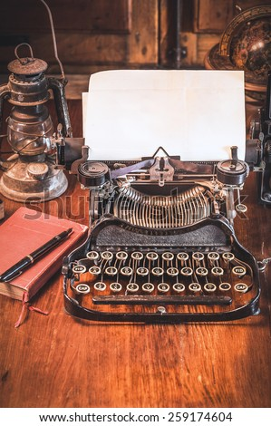 Traditional and old way of writing messages and taking photos, typewriter, camera, watch, pen, Vintage lamp on the desk #259174604
