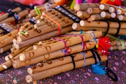 Traditional Andes pan flutes or panpipes on a market stall in Cusco, Peru. It is a traditional music instrument that can be found in Peru, Ecuador and Bolivia.