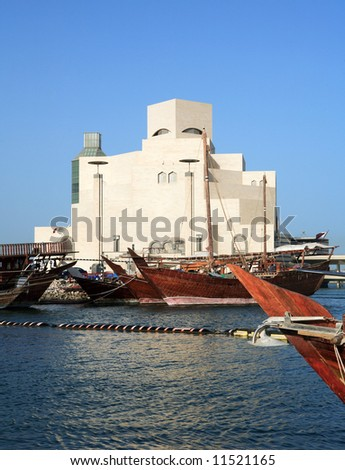 Traditional Arab dhows moored in the harbour beside the Museum of Islamic Art in Doha, Qatar. April 2008