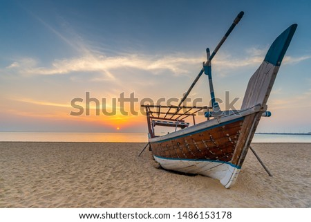 Traditional Arabian boat on a beach. Taken early morning on a beach near Al Wakrah, Qatar