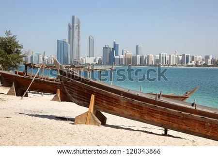 Traditional arabian boats on the beach of Abu Dhabi United Arab Emirates