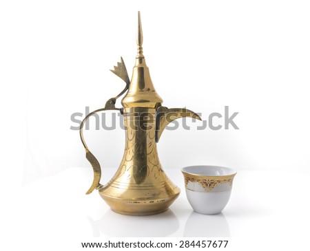 Traditional arabic coffee mug and coffee cup - stock image