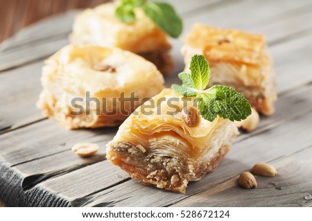 Traditional arabic dessert Baklava with honey, selective focus