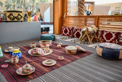 Traditional Arabic food sitting board or bench, tea pot and some hand made straw or wicker tools. Available in Riyadh, Saudi Arabia.