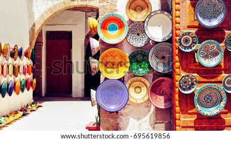 Traditional arabic handcrafted, colorful decorated plates in Morocco