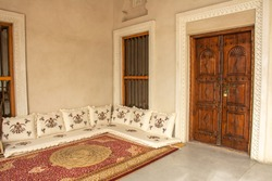Traditional Arabic style seating area with carpet and cushions in the United Arab Emirates
