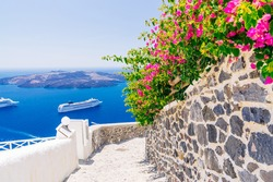 Traditional architectural detail of Santorini street, Fira village and volcanic caldera view, Greece