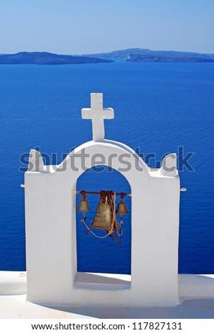 Traditional architecture of Oia village at Santorini island in Greece - stock photo