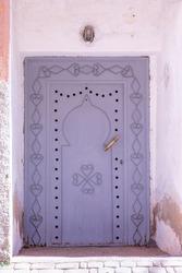 Traditional artisan entrance door in oldtown kasbah Morocco