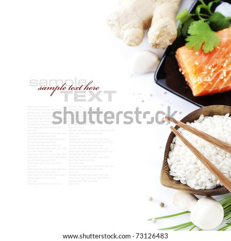 traditional asian ingredients (Fresh salmon steak filet, uncooked rice, ginger, garlic, mushrooms, soy sause and chopsticks) over white with sample text - stock photo