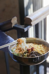 Traditional Asian noodle soup with meat