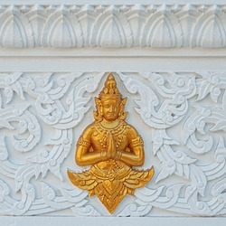 traditional Asian ornament on stone wall. decoration Elements of buddhist temple in Thailand. religion art national concept. Buddhism culture symbol.