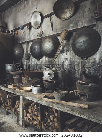 Traditional Asian style Kitchen interior with wok stove fire wood old and dirty.