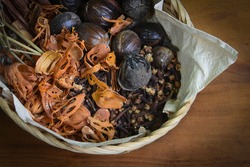 traditional assorted spices, include cengkih (cengkeh), fuli and pala in local language, collect in a bucket for healthy food