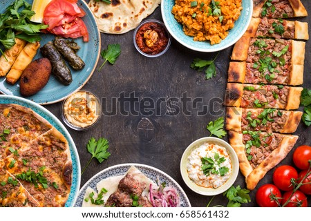 Traditional assorted turkish dishes background. Turkish pizza, meat kebab, pita, bulgur, fried meatballs, hummus and turkish meze set. Middle eastern dinner. Turkish cuisine. Top view. Space for text