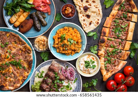 Traditional assorted turkish dishes. Turkish pizza, meat kebab, pita, bulgur, fried meatballs, hummus and turkish meze set. Middle eastern dinner. Food party. Turkish cuisine. Top view. Eastern food