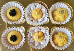 Traditional auspicious Thai desserts, exquisitely made in the shape of beautiful golden yellow flowers