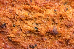 Traditional authentic Polish bigos. The meal with stewed sauerkraut, white cabbage, meat and sausage along with spices. Top view. Diet food background