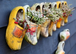 Traditional authentic wooden clog shoes, common for dutch peasants, selective focus. Traditional clothes and shoes