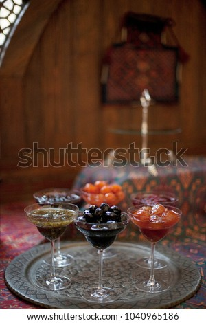 Traditional Azeri jam in a bowl on carpet