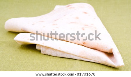 Traditional azeri lavash (bread) isolated on green