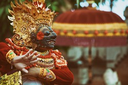 Traditional Balinese costume and mask Tari Wayang Topeng - characters of Bali culture. Temple ritual dance at ceremony on religious holiday. Ethnic festivals, arts of Indonesian people