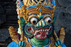 Traditional Balinese demon statue in the street temple. Island Bali, Indonesia . Close up