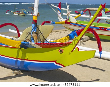 """Traditional balinese """"dragonfly"""" boat on the beach"""